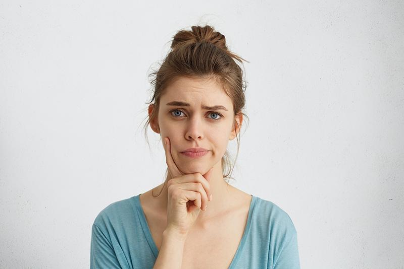woman wondering about endodontist dentist visit