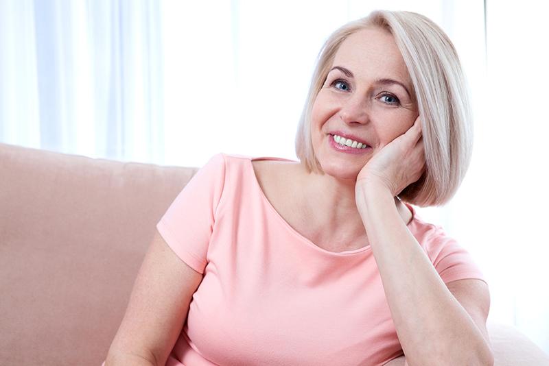 Woman smiling at dentist